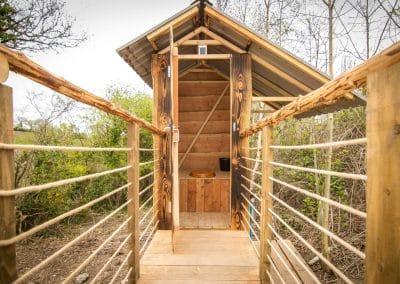 Derwen Yurt bridge to toilet